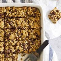 whole wheat oatmeal chocolate chip cookie bars in a baking dish