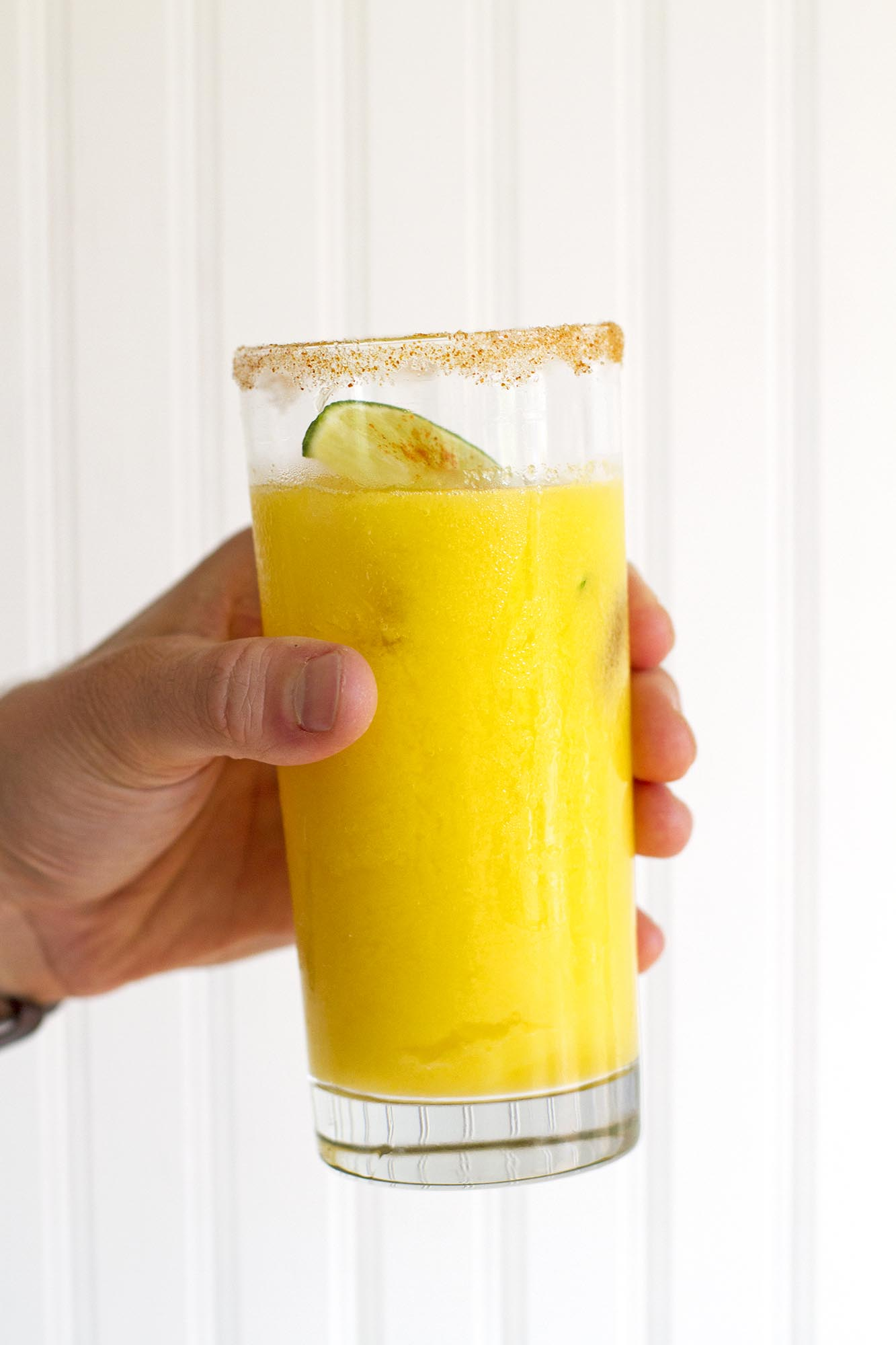 sparkling mango chili lime agua fresca in glass