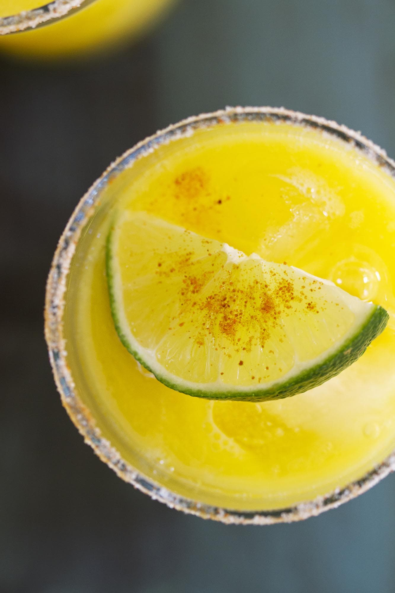 overhead view of mango chili lime agua fresca in glass
