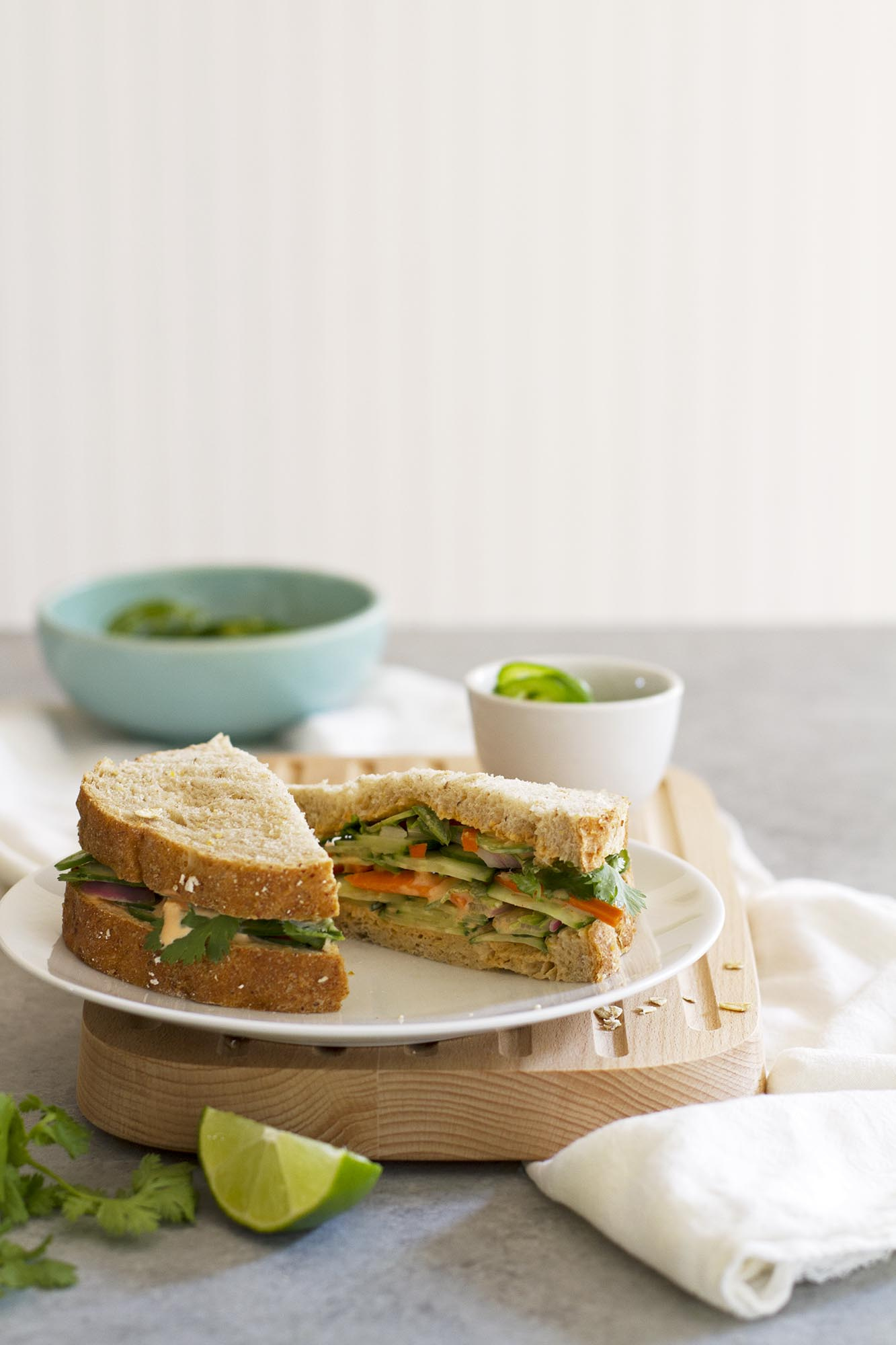 sliced spicy Thai veggie sandwich on plate