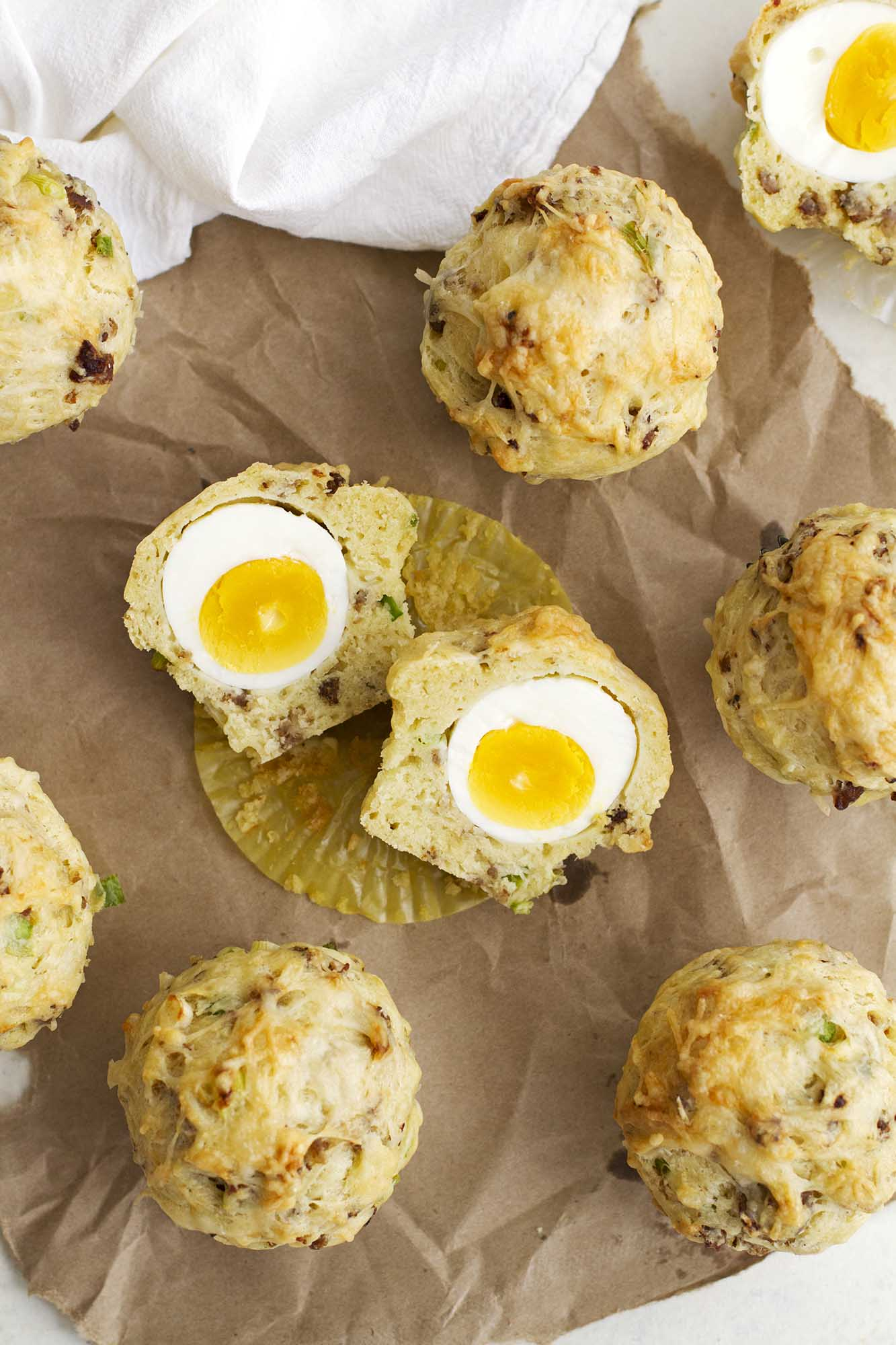 breakfast egg cheese muffins on parchment paper