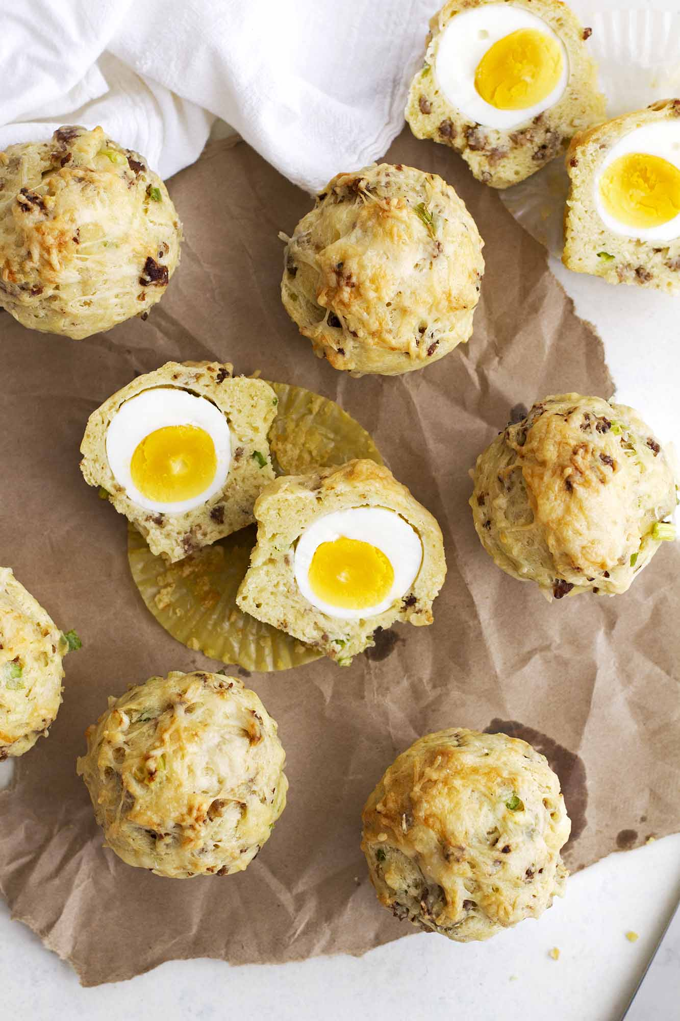 breakfast egg and cheese muffins on parchment paper