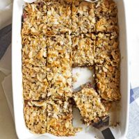 caramel coconut chocolate chip bars in baking dish