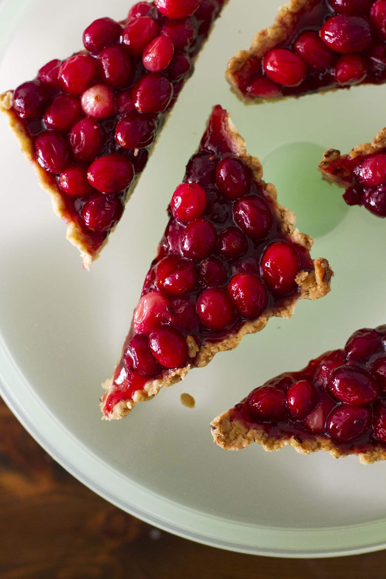 nut crusted cranberry tart slices on plate