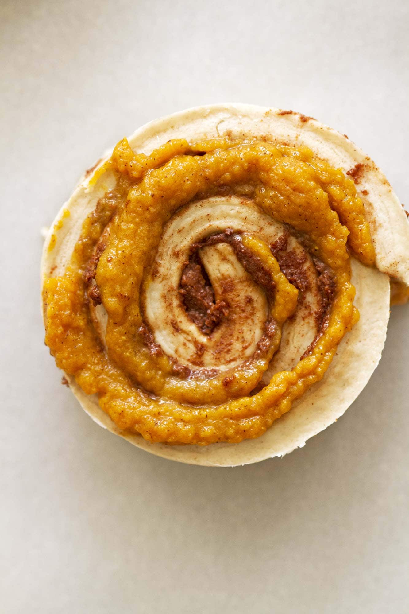 brown butter pumpkin cinnamon roll ready for baking