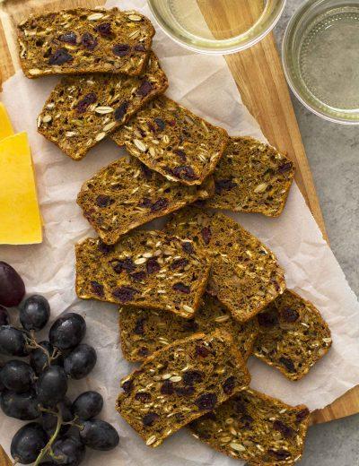 pumpkin cranberry flax crisps on cutting board
