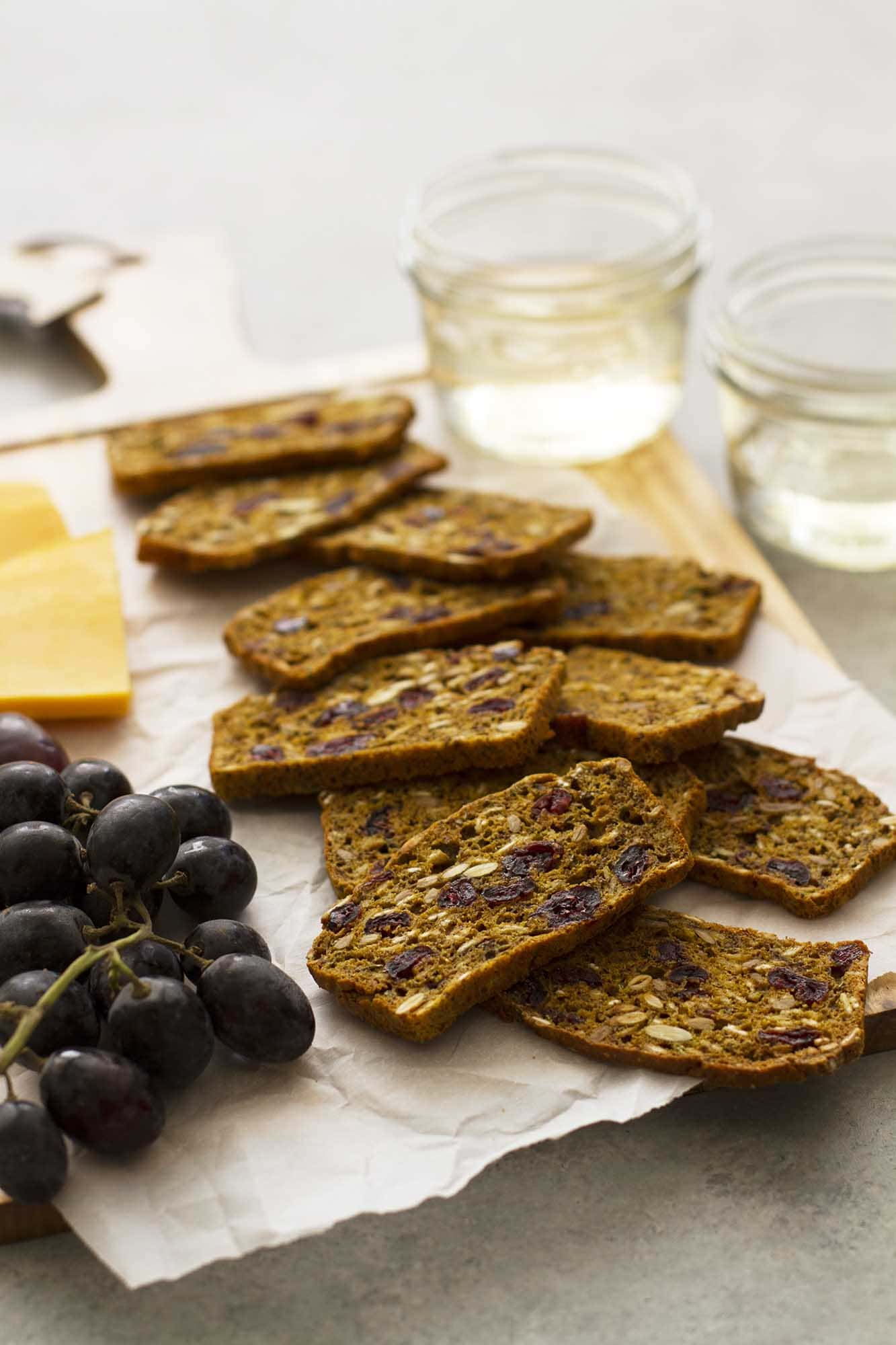 pumpkin cranberry flax crisps on cutting board