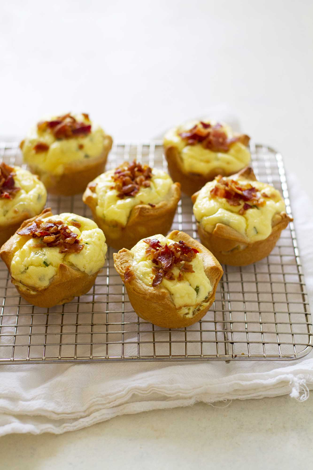 bacon quiche crescent cups on cooling rack