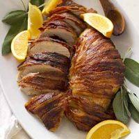bacon wrapped maple bourbon turkey breast on baking dish