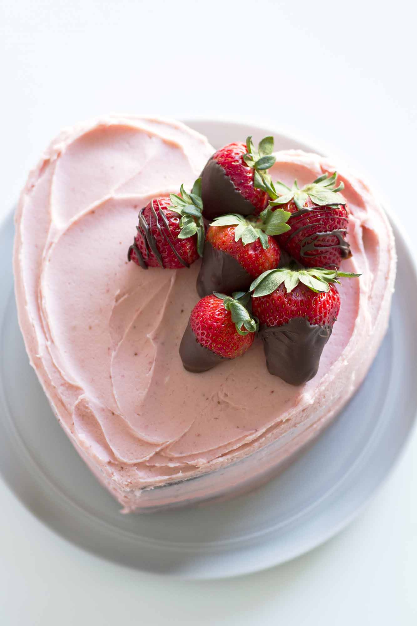heart shaped chocolate strawberry cake on plate