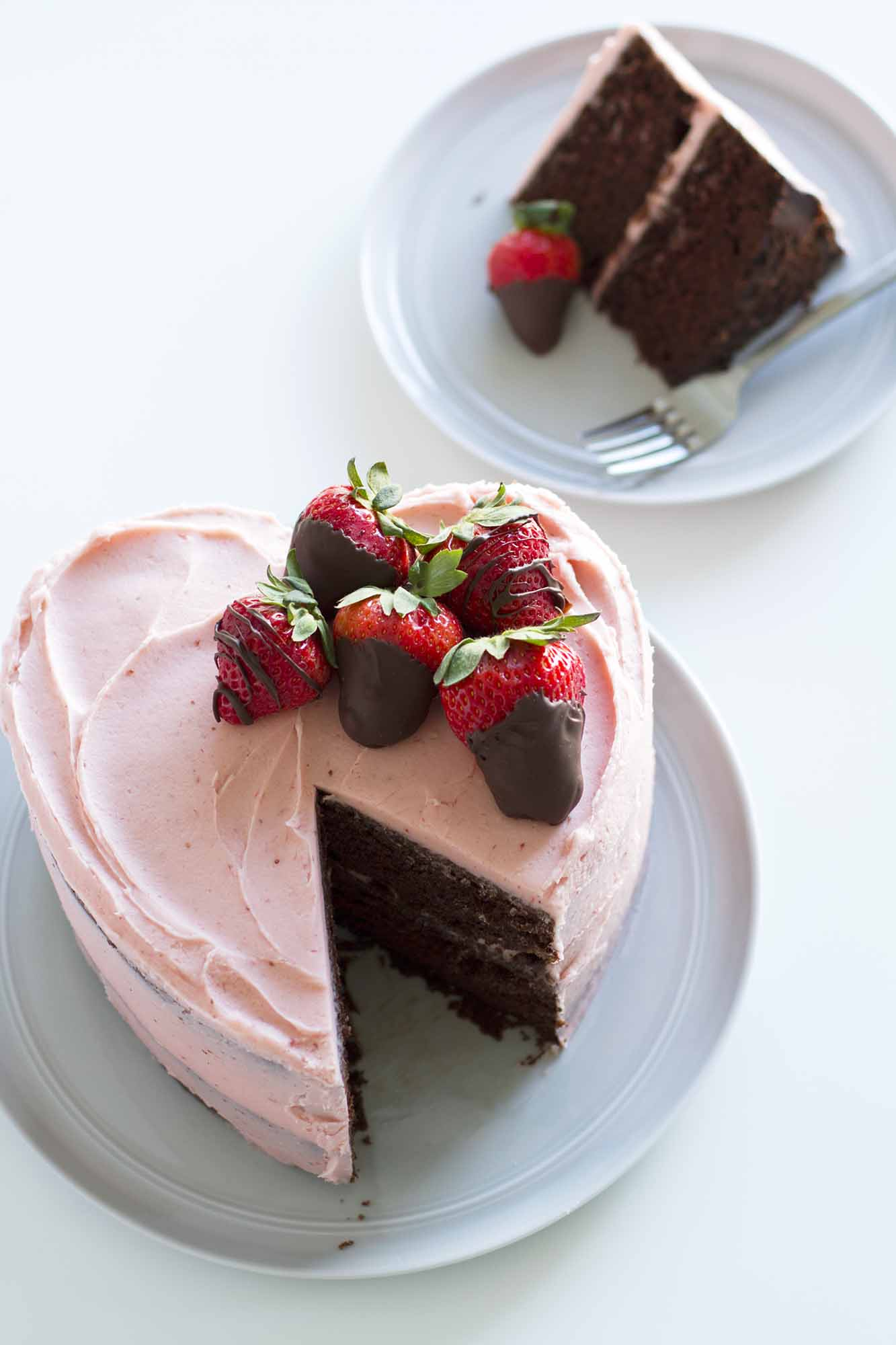 slice of heart shaped chocolate strawberry cake on a plate