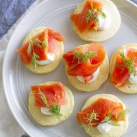 pancake blini with salmon and dill on plate