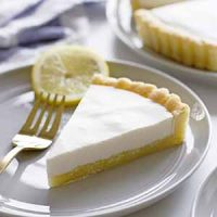 lemon buttermilk sugar cookie tart slice on plate