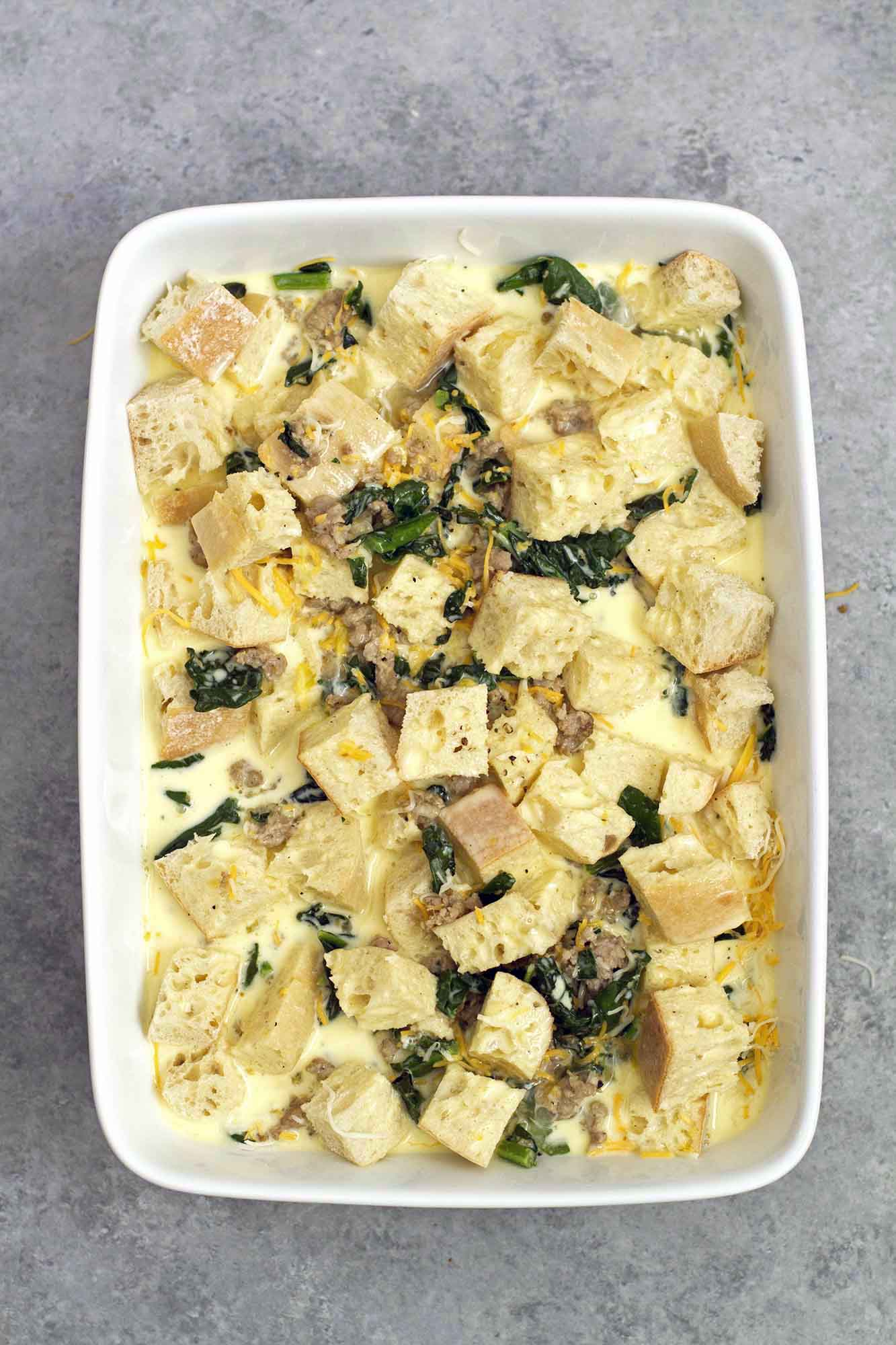 not your mom's egg casserole in dish before going in oven