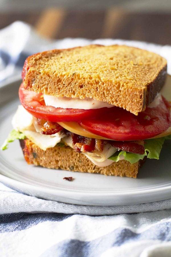 homemade turkey bacon bravo sandwich on plate