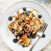 blueberry brioche french toast casserole on a plate