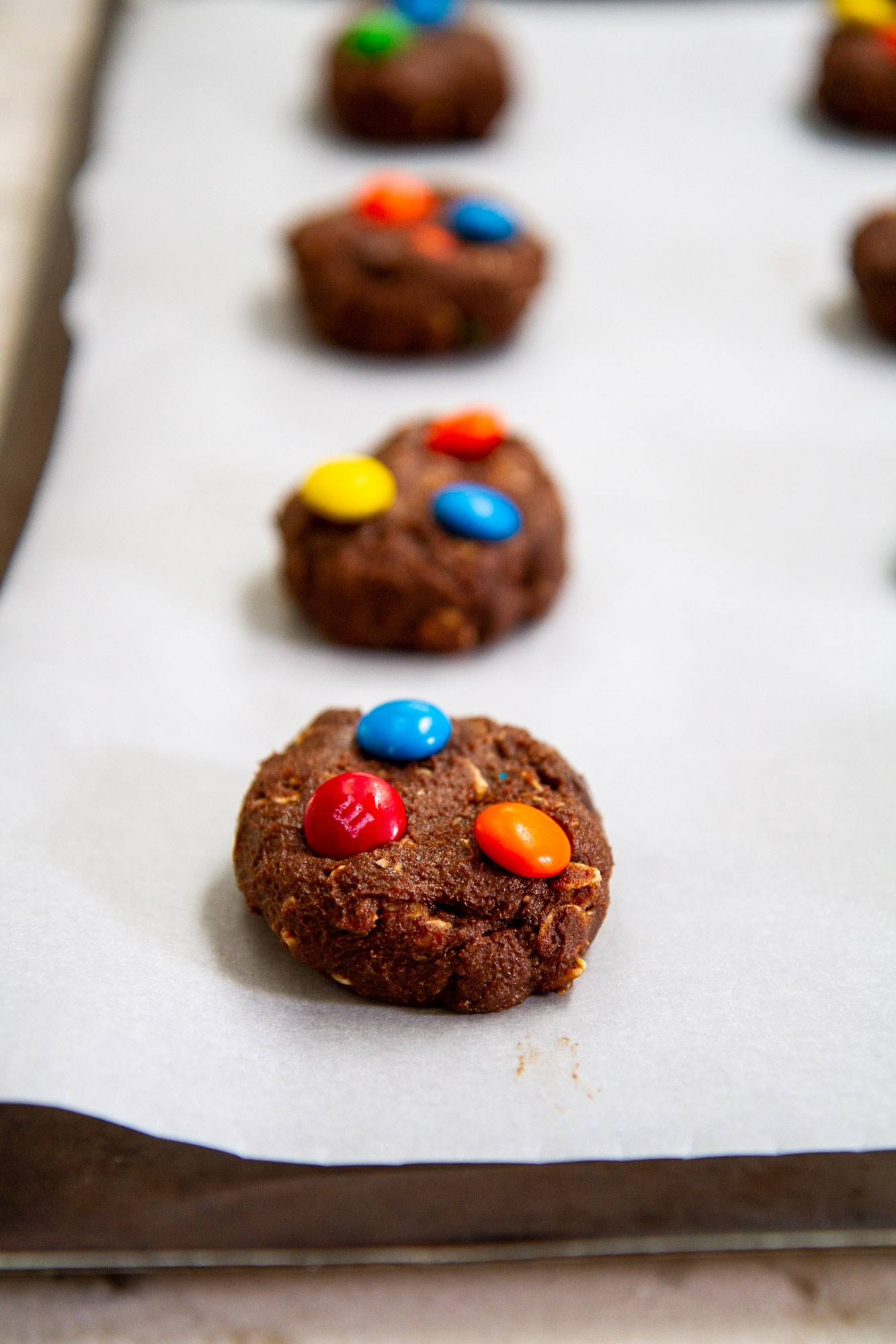 brownie monster cookie dough on baking sheet