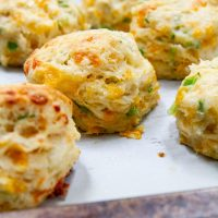 cheddar scallion biscuits on a baking sheet