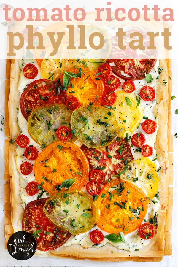 Tomato Ricotta Phyllo Tart -- a tender, flaky phyllo crust is topped with a bright ricotta spread, fresh tomatoes and herbs. This is a true celebration of summer in food form! girlversusdough.com @girlversusdough #girlversusdough #appetizer #easysidedish