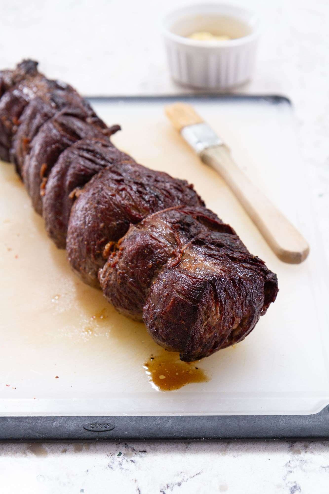 cooked beef on cutting board
