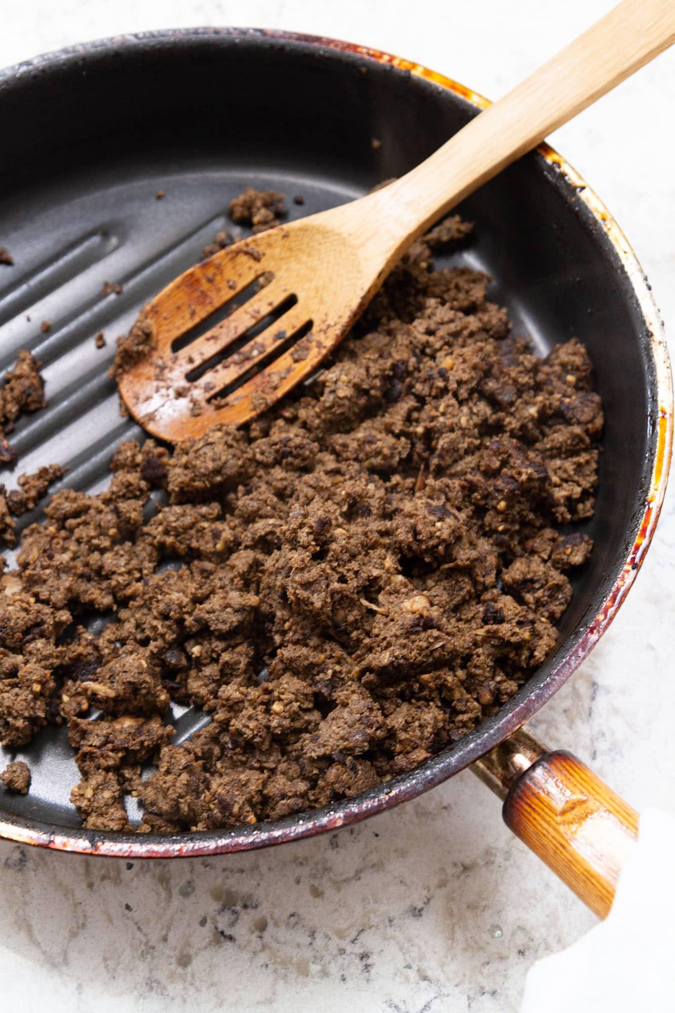 cooking mushrooms in pan