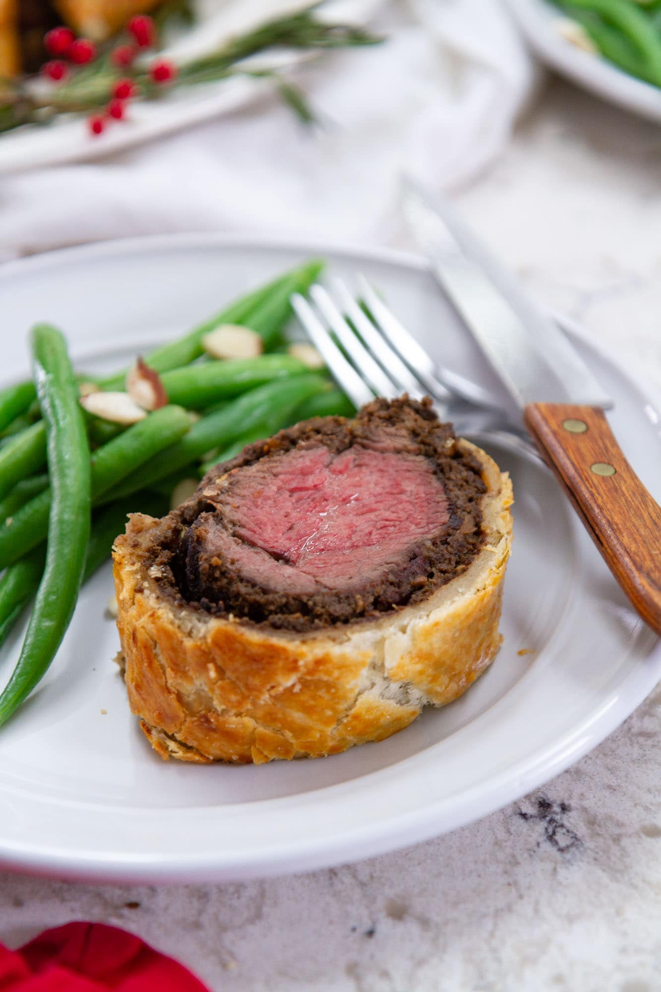 serving of beef wellington on plate