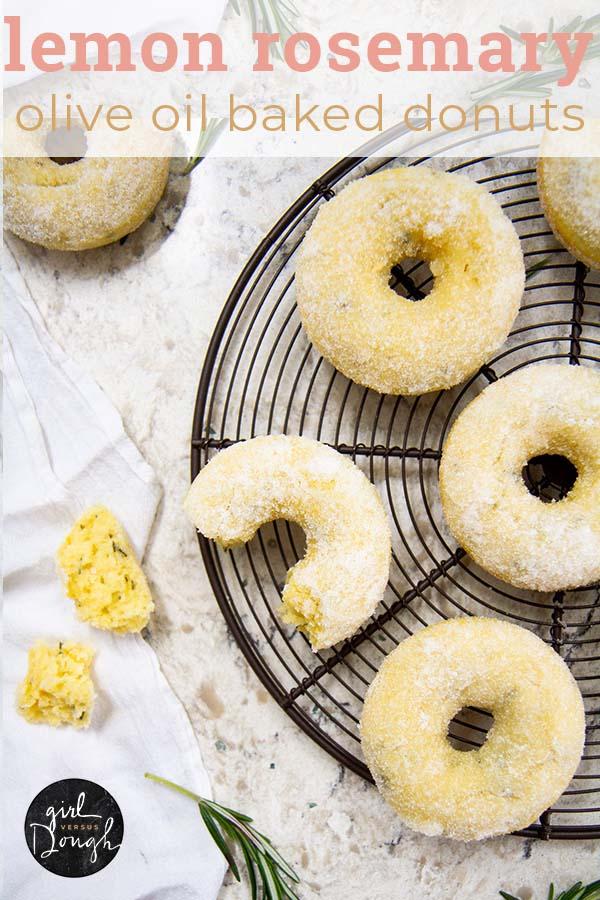 Lemon-Rosemary Olive Oil Cake Donuts -- A deliciously moist and tender baked donut recipe flavored with fresh lemon, rosemary, and olive oil and tossed in sugar. @girlversusdough #girlversusdough #doughnuts #breakfast