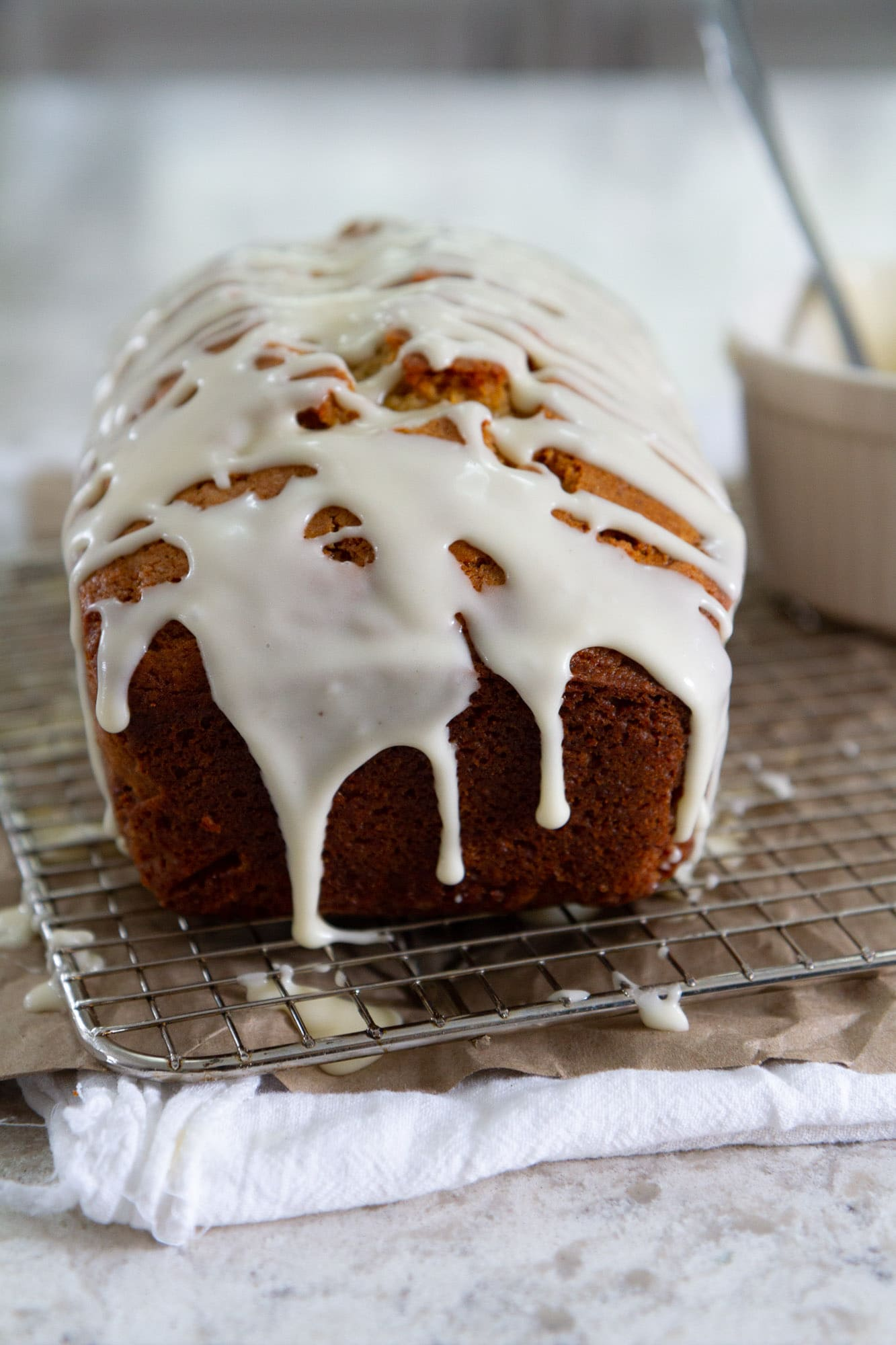 eggnog bread with spiced rum glaze on cooling rack