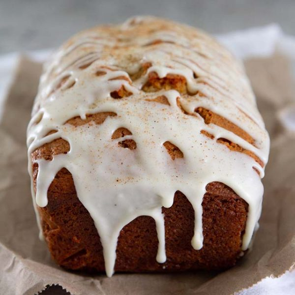 Eggnog Bread with Spiced Rum Glaze -- This eggnog bread recipe with spiced rum glaze tastes just like the holiday drink in quick bread form! @girlversusdough #girlversusdough #baking #dessertbread
