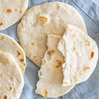 homemade soft flour tortillas on towel