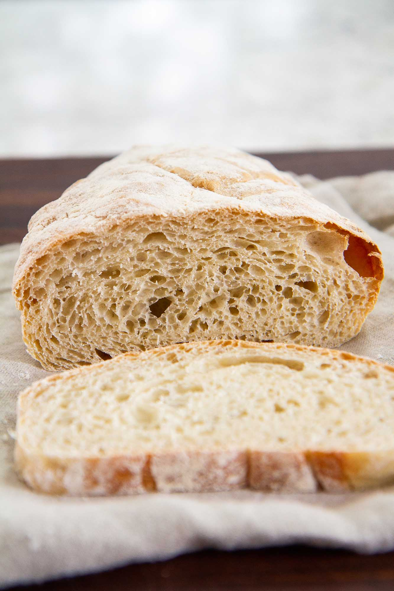 No Knead Ciabatta Bread -- A deliciously airy, crusty homemade ciabatta bread recipe that requires NO kneading. Perfect for toast, sandwiches and more. @girlversusdough #girlversusdough #nokneadbread #homemadebread #easybreadrecipe