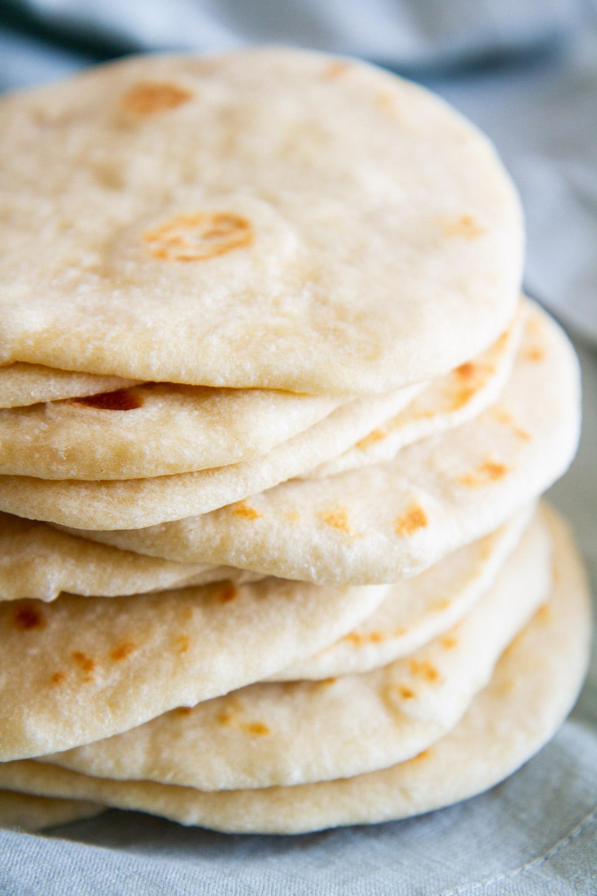 Homemade Soft Flour Tortillas -- delicious and exceedingly soft flour tortillas made from scratch with one special ingredient that makes them so good. @girlversusdough #girlversusdough #Mexicanfood #homemadebread #tacos