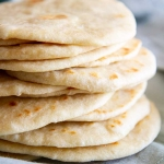 Homemade Soft Flour Tortillas -- delicious and exceedingly soft flour tortillas made from scratch with one special ingredient that makes them so good. @girlversusdough #girlversusdough #Mexicanfood #homemadebread #tacos