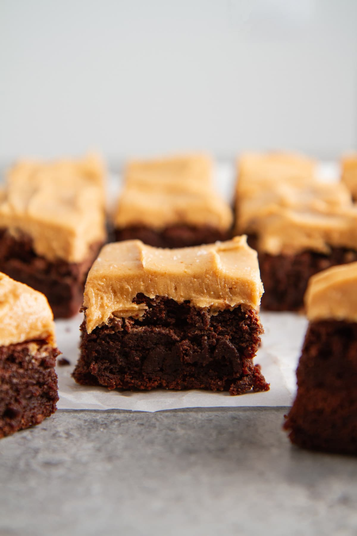 close up of fudgy brownie with cashew butter frosting