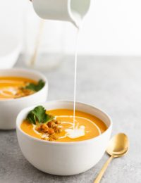 Carrot Ginger Coconut Soup -- A simple, satisfying vegan carrot ginger coconut soup recipe made with fragrant spices, creamy coconut milk and topped with roasted chickpeas. @girlversusdough #girlversusdough #veganrecipe #vegetarianrecipe #easysouprecipe