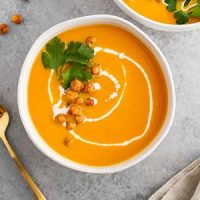 carrot ginger coconut soup in bowl