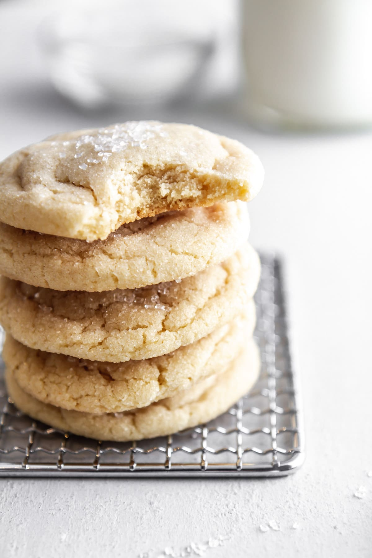 a stack of chewy sugar cookies on a cooling rack