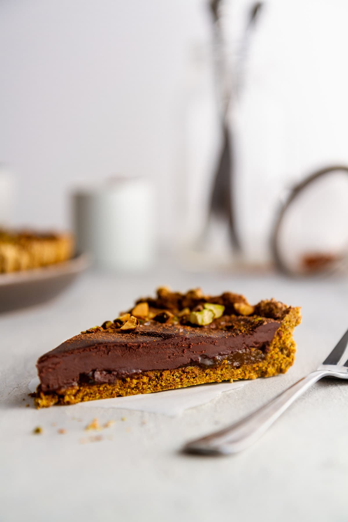 a slice of a chocolate tart on a surface