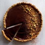 dark chocolate pistachio tart on a surface