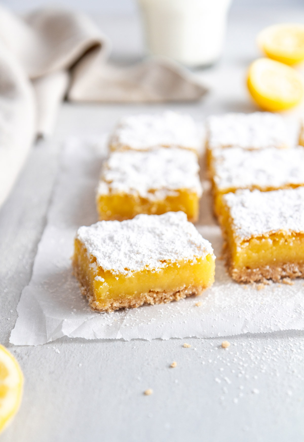 gluten free lemon bars on parchment paper