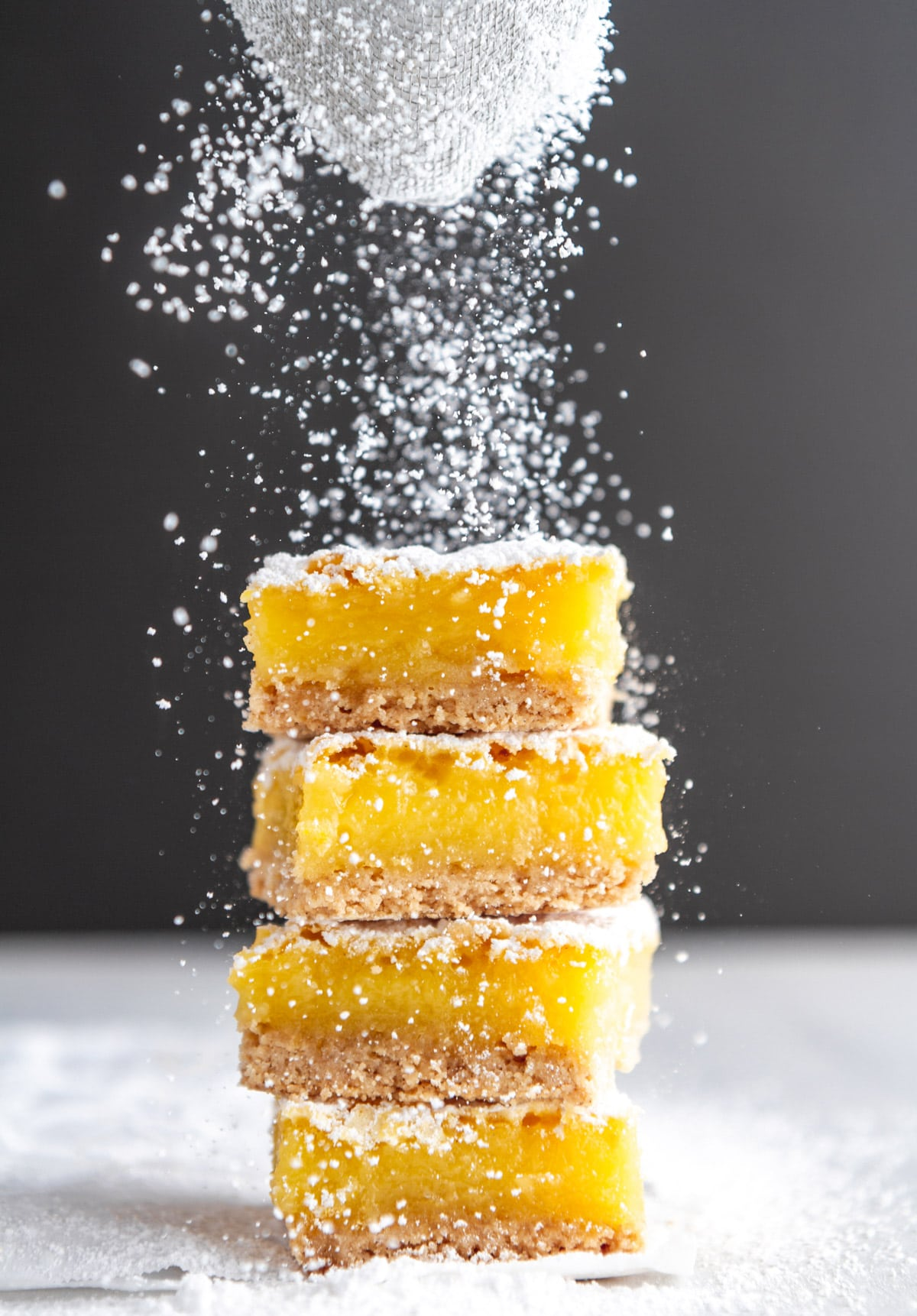 a stack of gluten free lemon bars dusted with powdered sugar