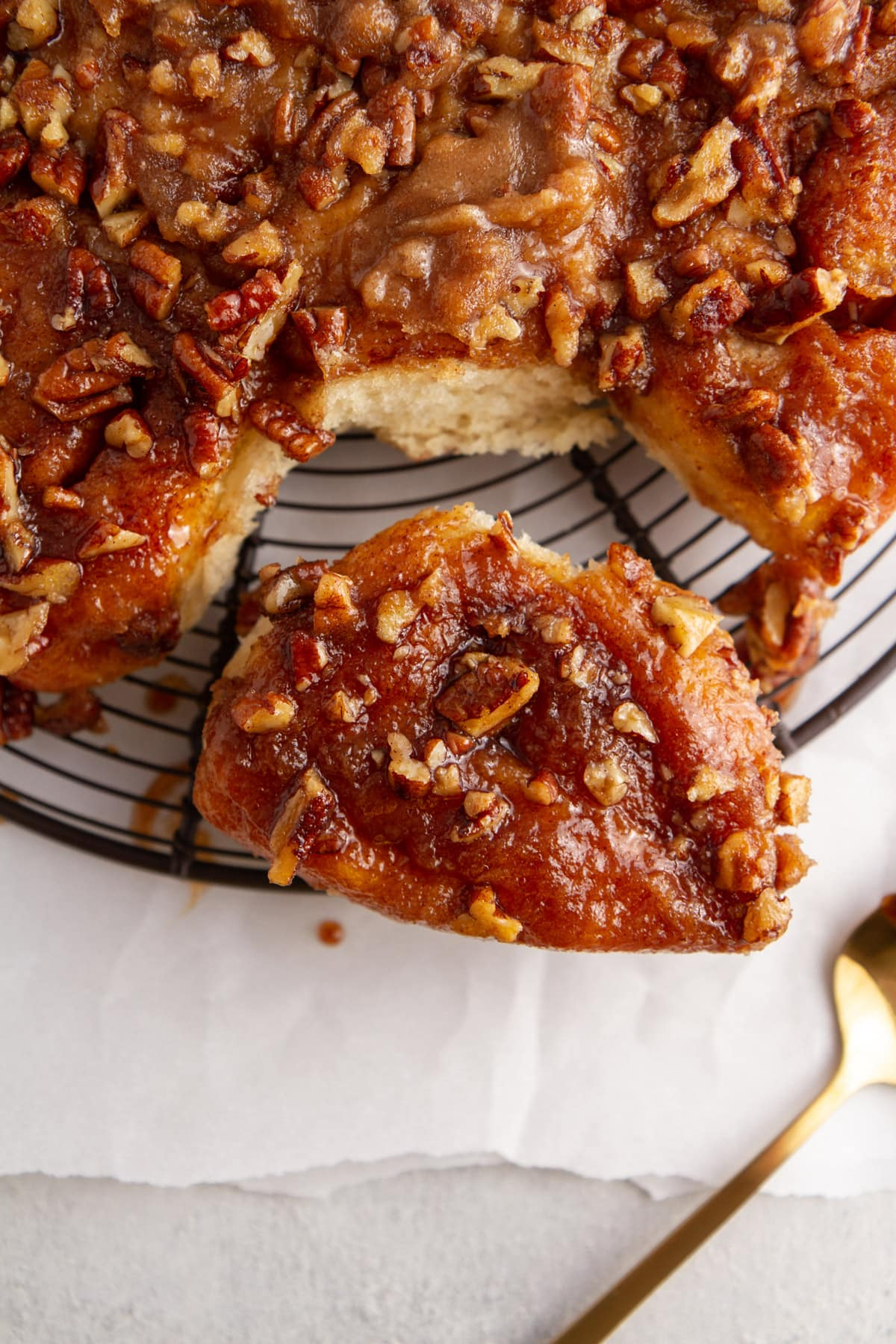 overnight caramel pecan sticky buns on cooling rack