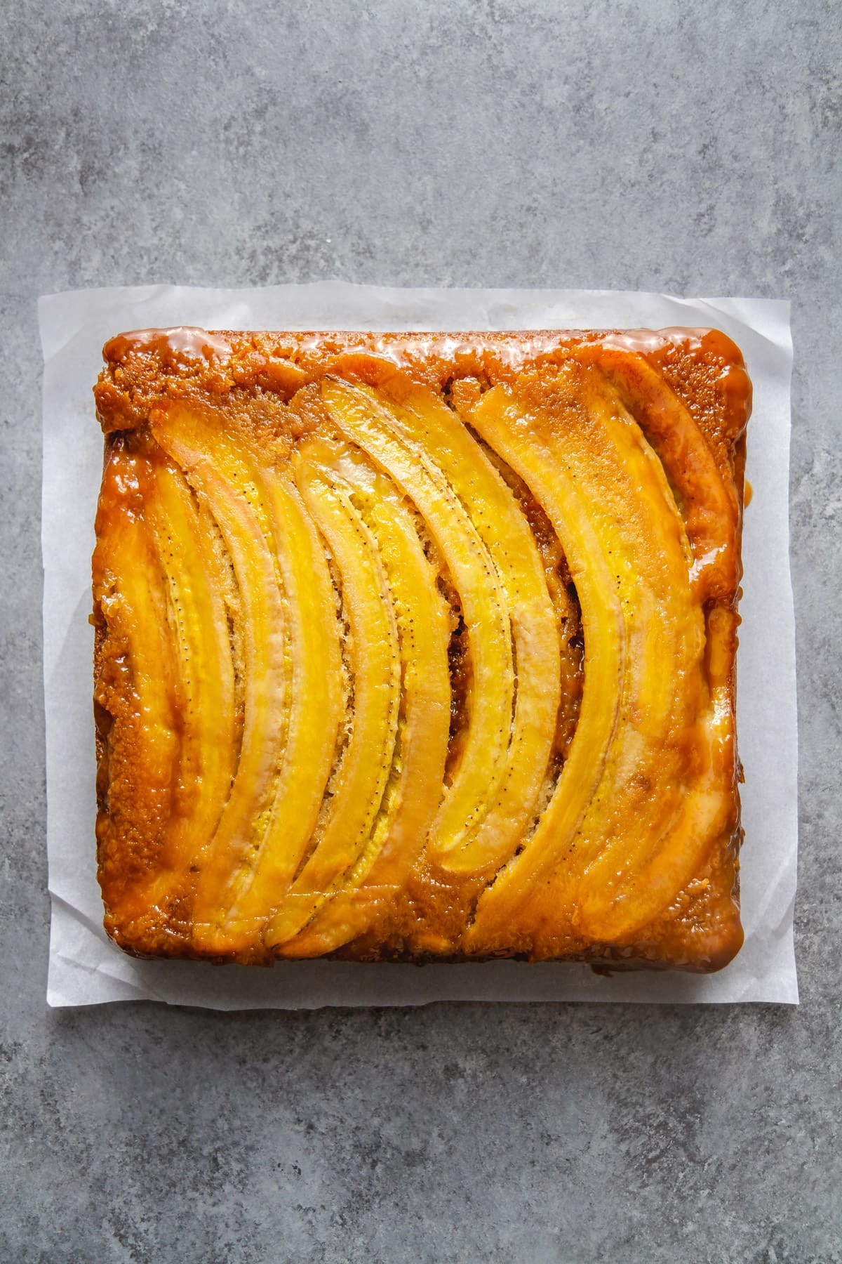 bananas foster upside-down cake on parchment paper