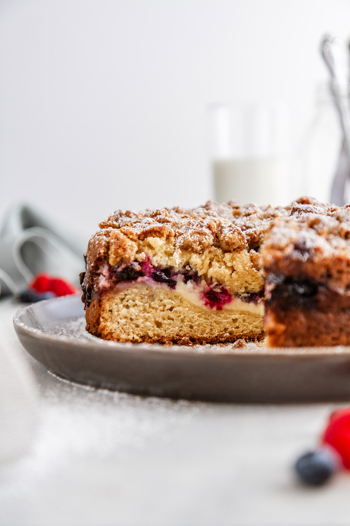 a slice of berry cream cheese coffee cake on a plate