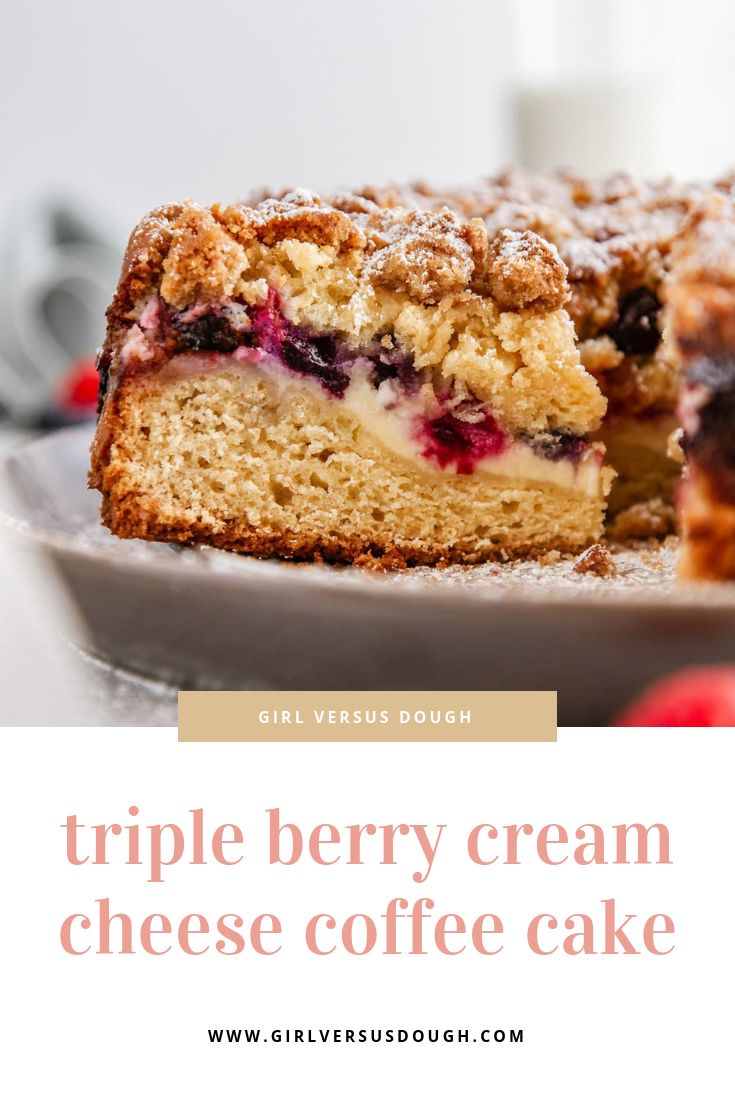 Triple Berry Cream Cheese Coffee Cake -- a dense but delicate berry-studded coffee cake with a ribbon of cheesecake filling and a thick crumb topping. The perfect brunch recipe! @girlversusdough #girlversusdough #coffeecakerecipe #berrycoffeecake
