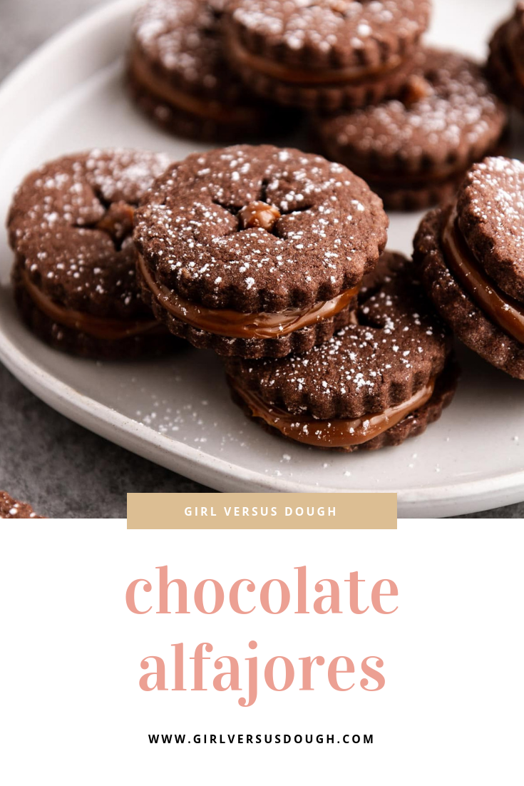 Chocolate Alfajores (Caramel Cookies) -- dulce de leche sandwich cookies with brownie-like chocolate roll-out cookies. Simple, yet so decadently delish. @girlversusdough #chocolatecookies #easycookiesrecipe #easydessert