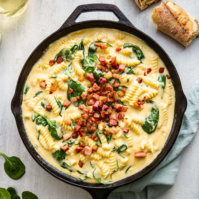 stovetop macaroni and cheese in a cast-iron skillet