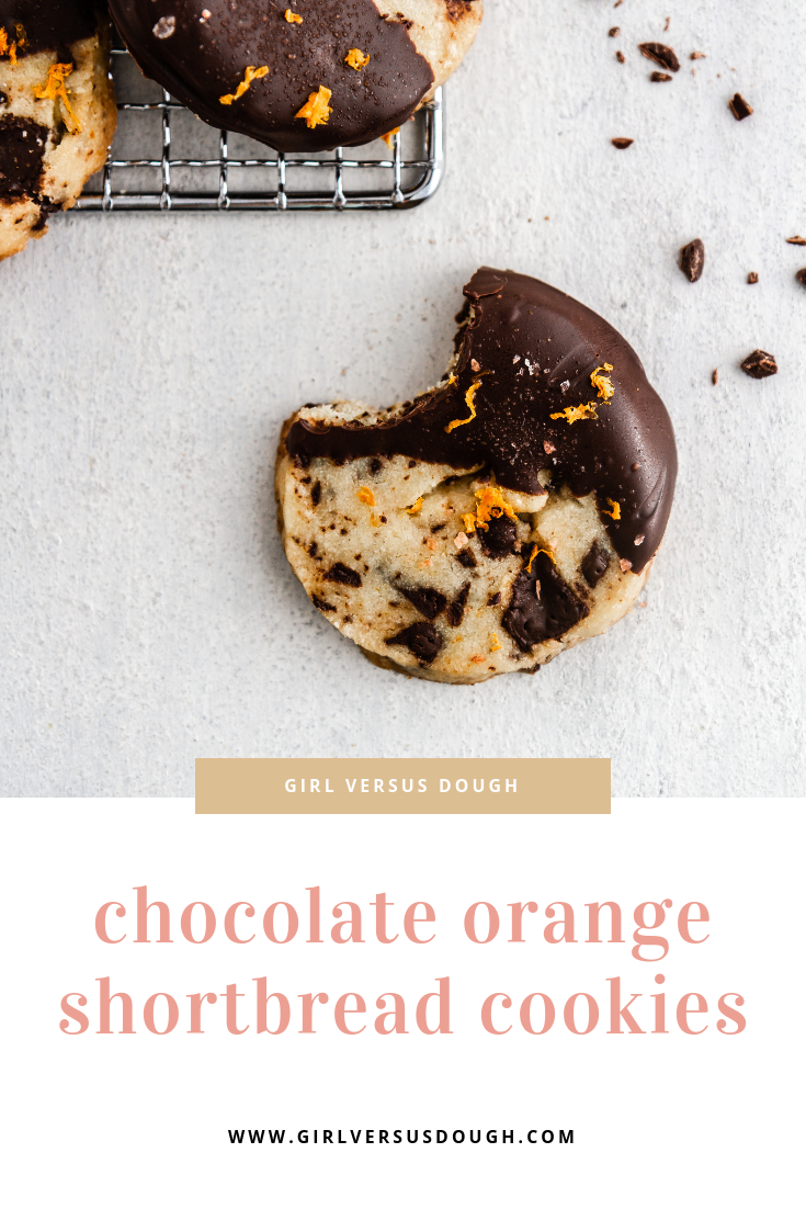 Slice and Bake Chocolate Orange Shortbread Cookies -- a chocolate chunk shortbread cookie recipe flavored with orange zest and dipped in chocolate. SO GOOD. @girlversusdough #girlverusdough #thecookies #chocolatechipcookie