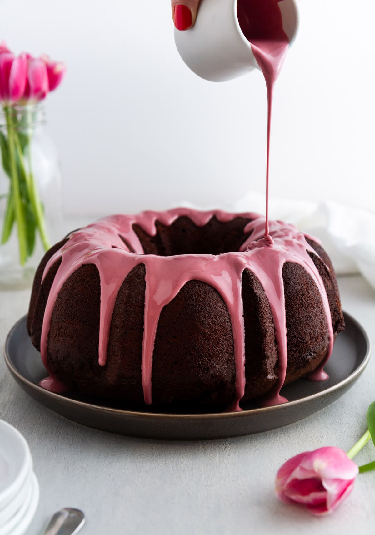 drizzling ruby chocolate on a chocolate bundt cake