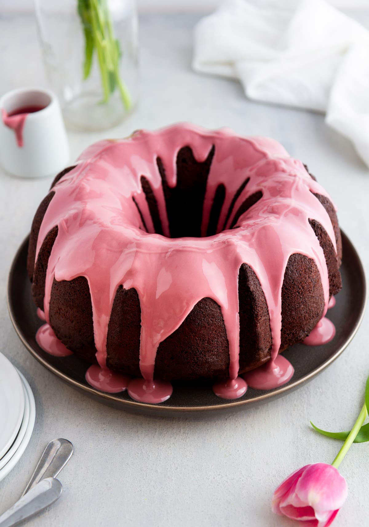 chocolate bundt cake with ruby chocolate glaze on a plate
